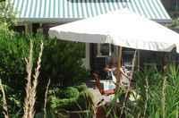 Onze achtertuin. In de zomer bij mooi weer serveren we hier het ontbijt -Our backgarden, in the summer we serve breakfast here.